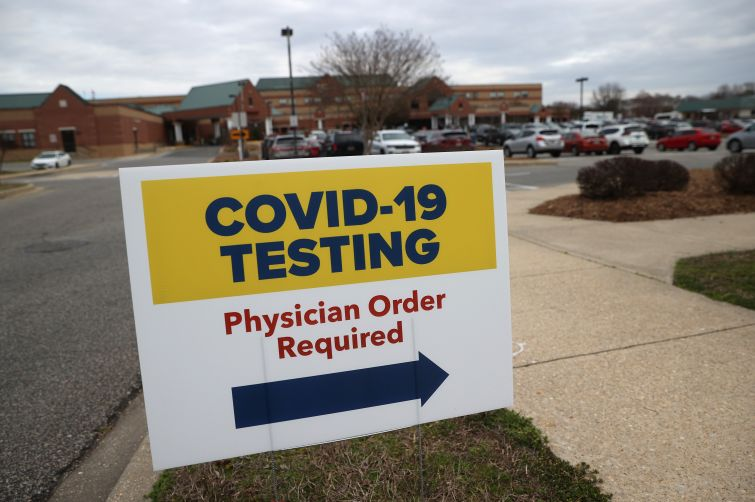 Sign directing patients to a COVID-19 testing drive-up location outside Medstar St. Mary's Hospital in Leonardtown, Maryland.