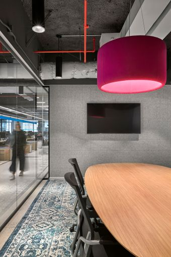 Light fixtures made of acoustic fabric help brighten spaces with fun colors and absorb sound in conference rooms and meeting areas.