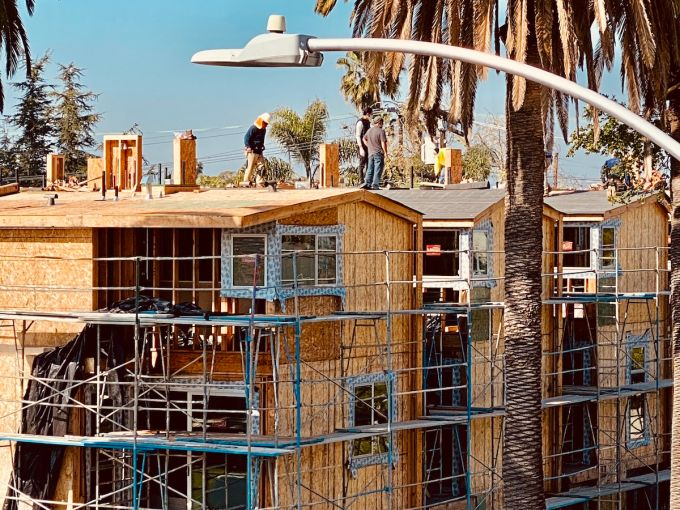 Crews continue work at a multifamily development on Willoughby Avenue off La Brea Avenue.