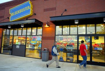 Customers enter a since-closed Blockbuster Video store in Wilsonville, Oregon.