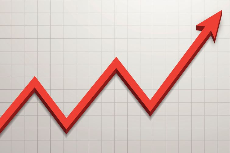 A photo of a red line graph rising.