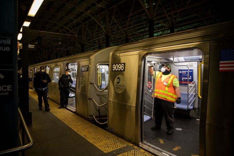 A worker disinfects a train at a subway station in Brooklyn.