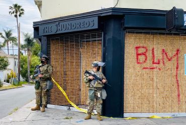 The Hundreds, a streetwear outlet at 501 Fairfax Avenue, is watched by National Guardsmen.