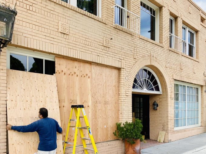 The store at 119 Larchmont is boarded up Tuesday.