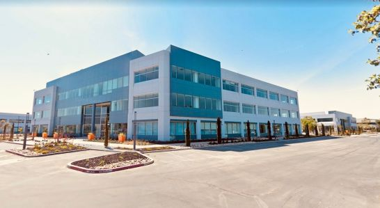 The property at 200 Holger Way in San Jose is one of the buildings leased to Raytheon and recently sold to EXAN Group. 100 Headquarters Drive is to the right.