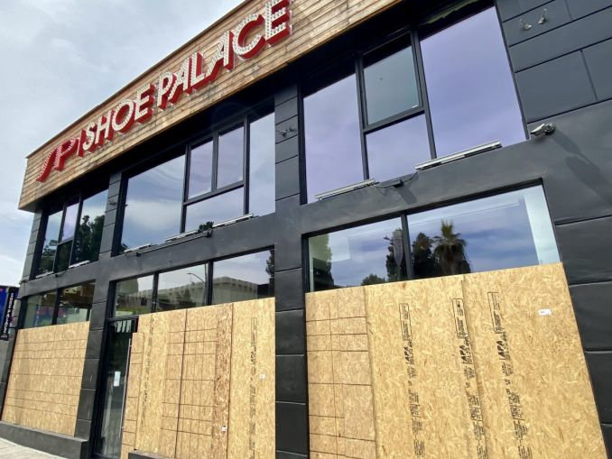 Shoe Palace at 7725 Melrose Avenue has been boarded up.