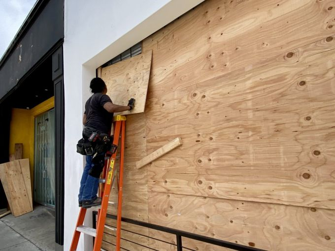 The store at 8020 Melrose Avenue is boarded up on June 2.