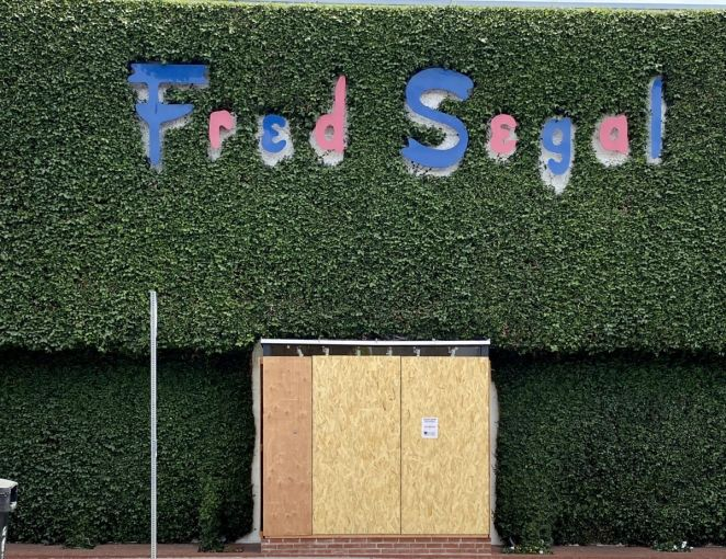 The iconic Fred Segal apparel store is boarded up at 8100 Melrose Avenue.