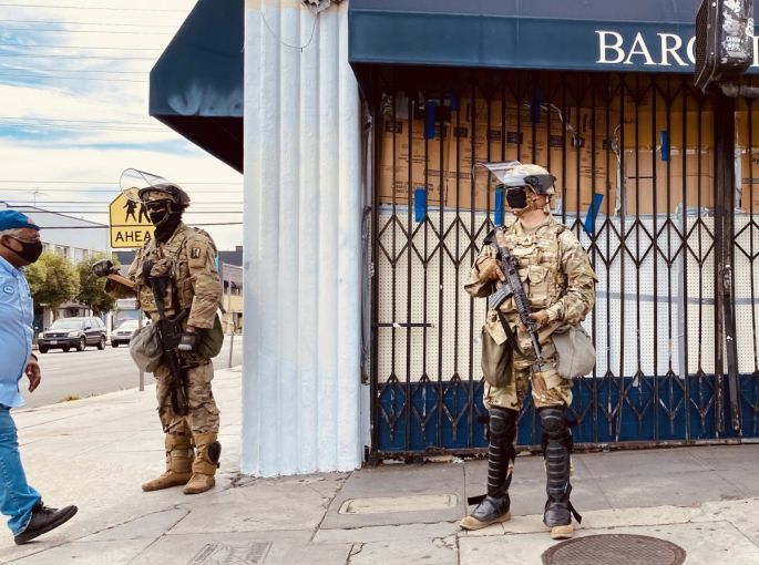 Bargain Fair at Beverly Boulevard and Fairfax Avenue is boarded up with National Guardsmen on June 2.