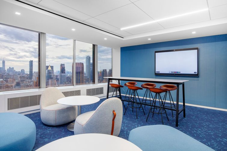 Conference rooms and common spaces feature walls and furniture in the company's signature royal blue color, which also appears in its logo.