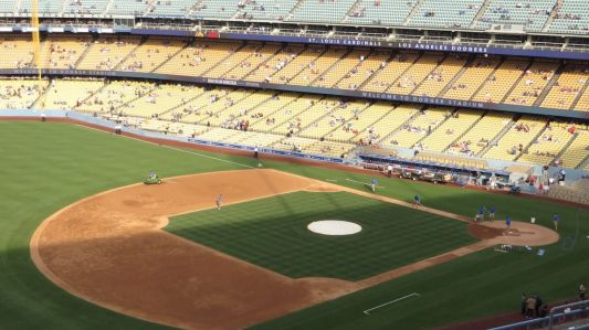 County officials announced that professional sports will do mostly without live audiences, and broadcasters will have to practice physical distancing. Cameras will also be in different locations. Above, Dodgers Stadium in Los Angeles.