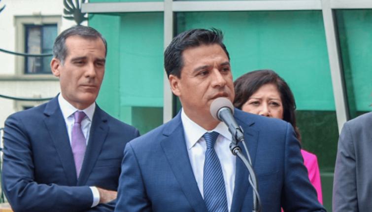 Councilman Jose Huizar, center, was arrested Tuesday.