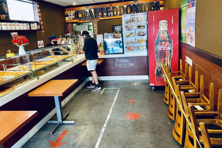 Shelter-in-place and social distancing orders led to massive layoffs and furloughs throughout California and Los Angeles. Above, Crafted Donuts on Wilshire Boulevard in L.A.