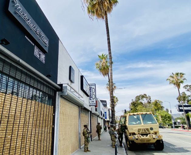 Mitchell & Ness and a row of other retailers on Fairfax have been boarded up.