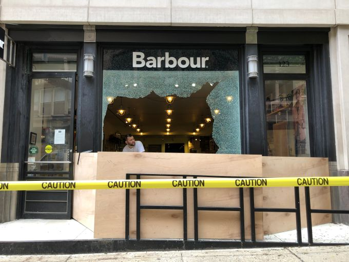 The exterior of a damaged Barbour store.