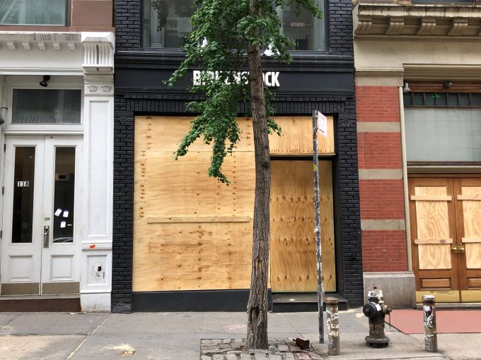 looted birkenstock boarded up