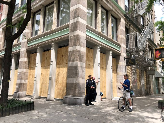 Officers protect a boarded up boutique on Spring Street in Soho on June 1, after the George Floyd protests turned violent the night before.