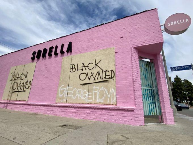 Sorella, a boutique fashion shop located at Melrose Avenue and Orange Grove, was boarded up.