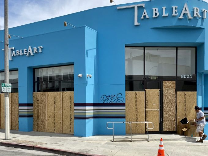 Table Art Inc. at 8024 Melrose Avenue has been boarded up.