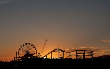 Officials are recommending that counties cancel firework shows for the holiday, and that residents do not gather with people they do not live with. Above, Santa Monica Pier.