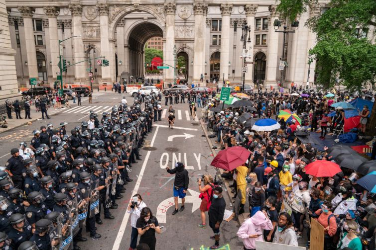 """Occupy City Hall"" protesters pushing for less police funding and more funding for social safety net programs face off with the police near City Hall in Manhattan this morning."