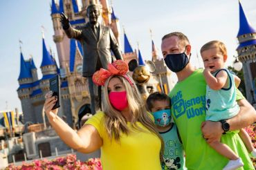 Guests stop to take a selfie at Magic Kingdom Park at Walt Disney World Resort on July 11, 2020 in Lake Buena Vista, Florida. July 11, 2020 is the first day of the phased reopening.