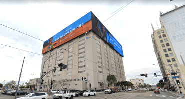 The three digital billboards wrap around the sides of the building, measuring about 55 feet by 245 feet.