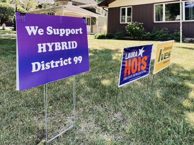 A lawn sign supports a hybrid mix strategy with both in-person and remote learning.