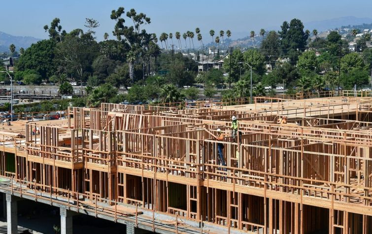A wood-framed building going up.