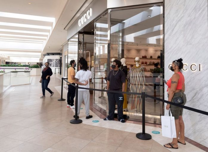 Customers wait online in South Coast Plaza mall