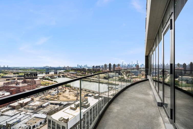 A view of the industrial South Bronx waterfront from the balcony of the newly completed Arches, a two-tower residential project in the Port Morris section of the South Bronx.