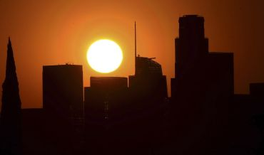 The sun sets behind Downtown Los Angeles on September 30. Third quarter office leasing dropped 18 percent from the second quarter.