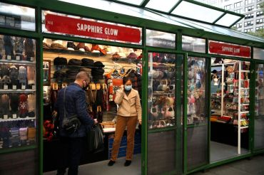 Shoppers are expected to spend an average of 20 percent less this holiday season, as the pandemic hits consumers' wallets. Shown here is the holiday market at Bryant Park, which opened last week.