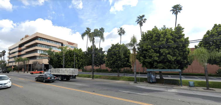 Amazon will demolish the printing plant next to the five-story office to the left, which is still available for sale or lease via developer Michael Harrah.