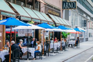 New Yorkers safely enjoy outdoor dining at Arno Ristorante in the Garment District.