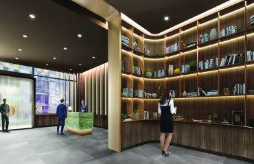 The lobby at 545 Madison Avenue will be renovated with a number of midcentury touches, including a wood paneled library.