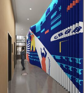 The narrow lobby at 625 Broadway is getting a unique mural painted on a wall of triangular metal blades.