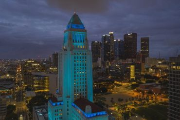 Los Angeles City Hall illuminated in blue in Downtown.