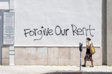 Graffiti asks for rent forgiveness on La Brea Avenue in Los Angeles. California's current moratorium lasts until until Feb. 1, 2021.