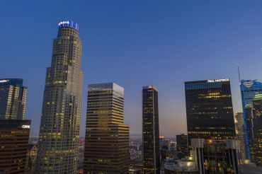 The U.S. Bank Tower, left seen in Downtown Los Angeles in May, shortly before it sold to Silverstein Properties. The tower and other high-rise office buildings have been absent more often than filled with workers since March when Gov. Gavin Newsom ordered Californians to stay home during the coronavirus (COVID-19) pandemic.