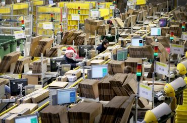 Staff label and package items in the on-site dispatch hall inside one of Amazon's warehouses, as the online shopping giant gears up for the Christmas rush.