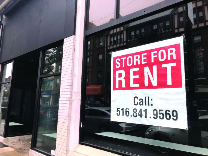Store for Rent sign, due to Coronavirus Pandemic shutdown and loss of business, Queens, New York