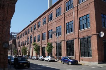 Building 127, a former shipbuilding warehouse at the Brooklyn Navy Yard, has attracted two new industrial design tenants.