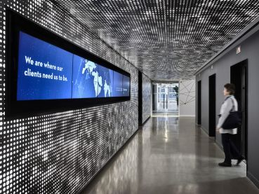 EisnerAmper's new office space, designed by Francis Cauffman Architects, includes an LED-lit elevator lobby with a 12-foot-long video wall.