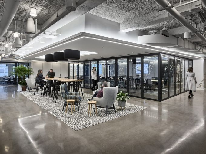 An open meeting space and a conference room.