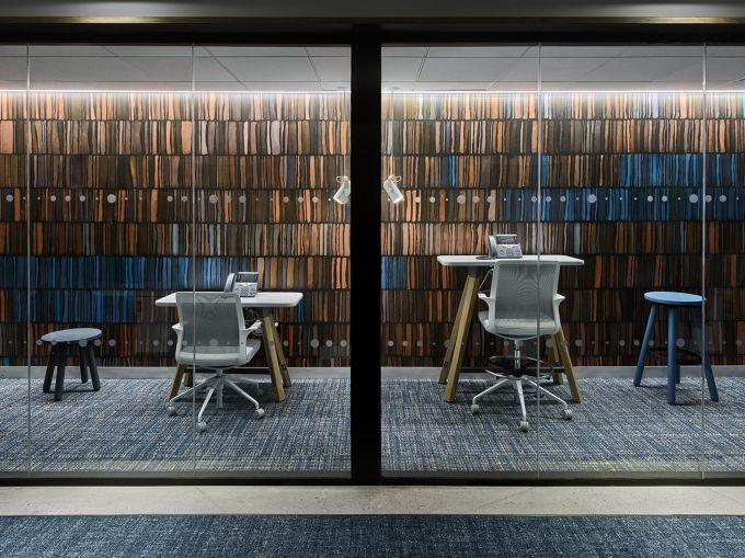 Conference rooms and small meeting rooms have colorful feature walls.