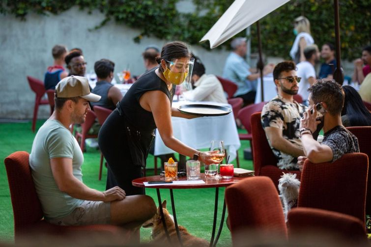 People have drinks and dine on the outdoor patio at La Boheme in West Hollywood. With the stay-at-home order lifted, restaurants to restart outdoor dining.