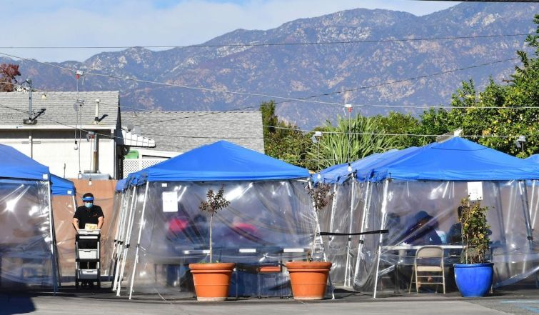 Tents for outdoor dining are seen in a restaurant's parking lot in November. Restaurants, wineries and breweries remain open for pick-up, delivery and take-out only until Jan. 29, at which point they will be allowed to reopen with restrictions.