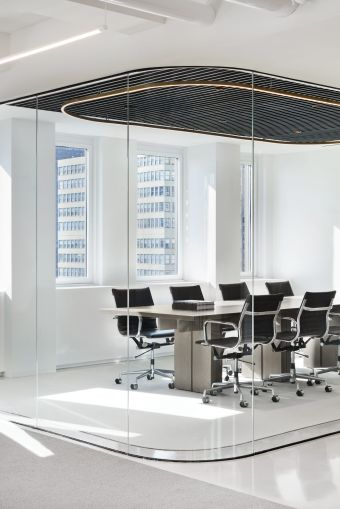 A conference room was encased in rounded glass to let in as much light as possible.