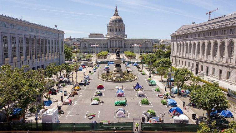 Squares painted on the ground to encourage homeless people to keep to social distancing at a city-sanctioned homeless encampment across from City Hall in San Francisco in 2020, amid the novel coronavirus pandemic.